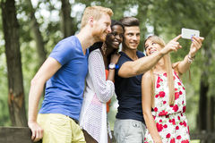 Group of young people and couples taking selfies in nature Royalty Free Stock Photo