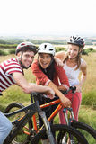 Group Of Young People Cycling In Countryside Stock Photos