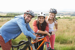 Group Of Young People Cycling In Countryside Stock Photo