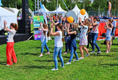 Group of young people dancing in the Park at the town festival Royalty Free Stock Photos