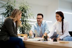 Group of people discussing plans in informal atmosphere stock image