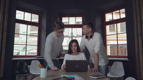 Group of young people discussing work. Leader of business group makes a comment and editing pointing some important data in project. Businesswoman sitting at the stock footage