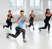 Group of young people doing fitness exercices royalty free stock image