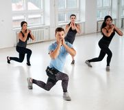Group of young people doing fitness exercices stock images