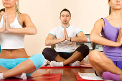 Group of young people doing yoga Stock Photography