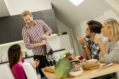 Group of young people drinking wine in the room royalty free stock photos