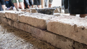 group of young people earth building the wall of earthen house Royalty Free Stock Image