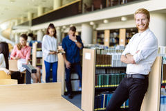 Group of young people educating themselves in a library Royalty Free Stock Image