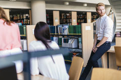 Group of young people educating themselves in a library Royalty Free Stock Photography
