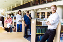 Group of young people educating themselves in a library Stock Images