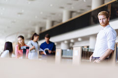 Group of young people educating themselves in a library Royalty Free Stock Images