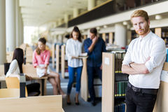 Group of young people educating themselves in a library Stock Photography