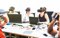 Group of young people employee workers having fun with vr virtual reality royalty free stock photo