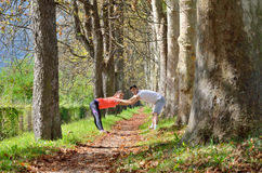 Group of young people enjoying the fitness and bright sunshine Royalty Free Stock Images