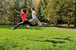Group of young people enjoying the fitness and bright sunshine Stock Photos