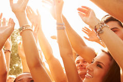 Group Of Young People Enjoying Outdoor Music Festival stock photography