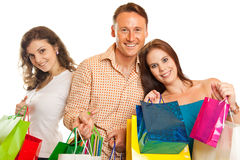Group Of Young People Enjoying Their Shopping Spree. Studio shot of three young people enjoying a sale event Royalty Free Stock Photography