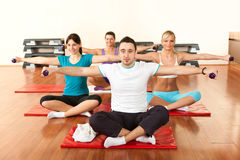 Group of young people exercising with dumbbells Royalty Free Stock Photo