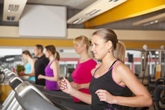 Group of young people exercising in gym Stock Image