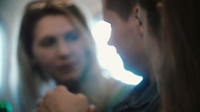Group of young people flying on the plane together. Happy friends, man and woman talking, going to the trip. stock footage