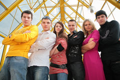 Group of young people on footbridge Stock Image