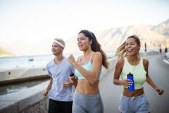 Group of young people friends running outdoors at seaside. Group of happy young people friends running outdoors at seaside stock image
