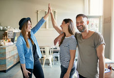 Group of young people gesturing and smiling Royalty Free Stock Image