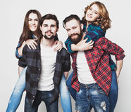 Group Of Young People Giving Piggybacks Stock Photos
