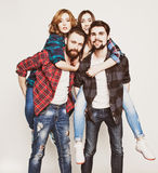 Group Of Young People Giving Piggybacks Royalty Free Stock Photos