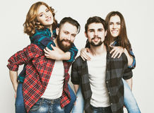 Group Of Young People Giving Piggybacks Royalty Free Stock Photography