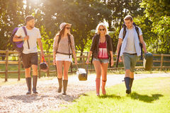 Group Of Young People Going Camping At Music Festival Stock Images