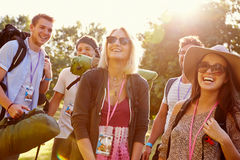 Group Of Young People Going Camping At Music Festival Stock Photography
