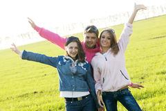 Group of young people on a green field Stock Image