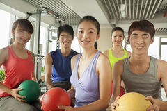 Group of young people in the gym, portrait Royalty Free Stock Image