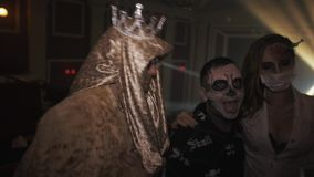 Group of young people in halloween costumes dancing for camera at night club stock video footage
