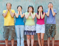 Group of young people with hands on eyes Royalty Free Stock Photo
