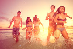 Group of young people having fun on beach Stock Photo