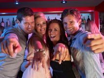 Group Of Young People Having Fun In Busy Bar. Group Of Young People Having Fun Smiling In A Busy Bar stock images