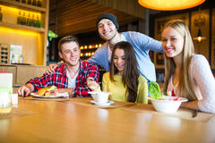 Group of young people having fun in cafe Stock Photo