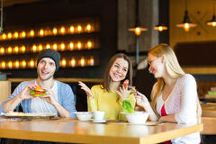 Group of young people having fun in cafe Royalty Free Stock Photos