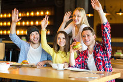 Group of young people having fun in cafe Royalty Free Stock Image