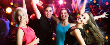 Group of young people having fun dancing at party royalty free stock photography