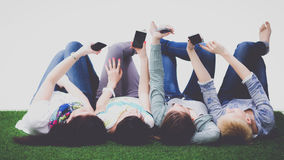 Group of young people having fun in Grass stock image