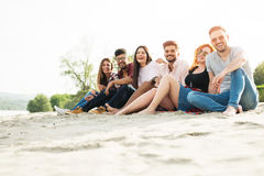 Group of young people having fun outdoors on the beach Royalty Free Stock Photo