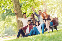 Group of young people having fun outdoors Royalty Free Stock Images