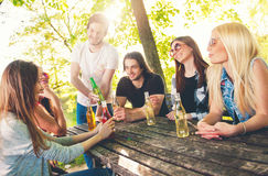 Group of young people having fun outdoors Royalty Free Stock Photos