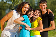 A group of young people having fun in the park Royalty Free Stock Photo
