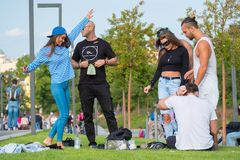 Group of young people having fun in the park at day time. Moscow, Russia - September 9, 2017: Group of young people having fun in the park at day time Stock Images