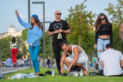 Group of young people having fun in the park at day time. Moscow, Russia - September 9, 2017: Group of young people having fun in the park at day time Stock Photography