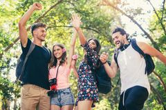 Group of young people having fun in park Royalty Free Stock Image